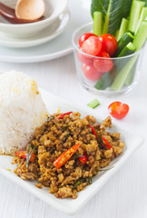 Southern Thailand Spicy fried pork with chili paste and herb