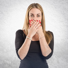Young girl doing surprise gesture over white background