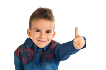 Kid with thumb up over white background