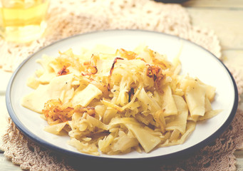 Noodles with stewed cabbage.