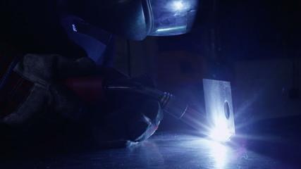 Welder working in a dark environment
