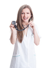 Woman doctor pointing stethoscope to the camera
