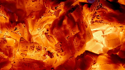 Closeup of fire and amber in a fireplace, campfire