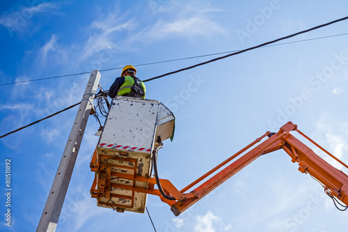 Power line team at work on a pole - 80511892