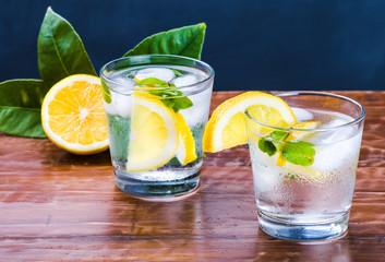 Glass with fresh drink, slices of lemon, mint.Lemonade.