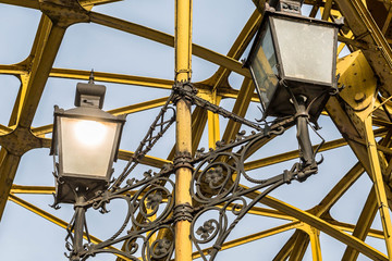 Decorative lamps hanging from bridge