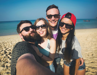 Multiracial friends make selfie at beach on vacation