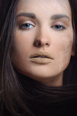 Young beautiful woman in nature makeup powder