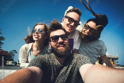 Leinwandbild Motiv Multiracial friends make selfie in Phuket Thailand while travel