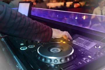 DJ playing music in the nightclub