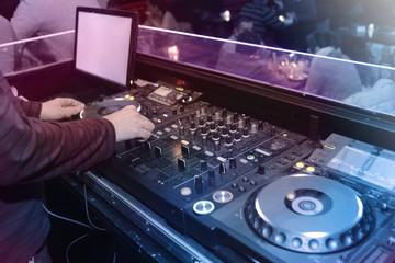DJ playing music in the nightclub
