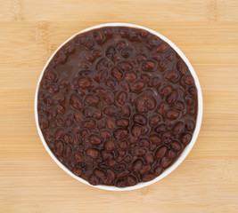 Plate of black beans in a chili sauce
