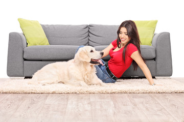 Woman sitting on the floor with a dog