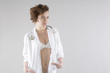 Young woman posing in doctor uniform with stethoscope
