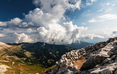 Mountain valley with clouds