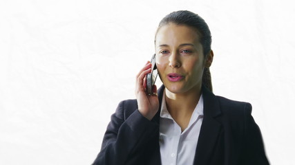 Businesswoman makes a phone call on white background
