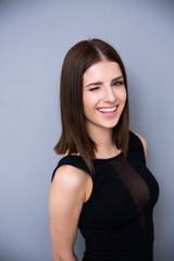 Portrait of attractive cute woman winking