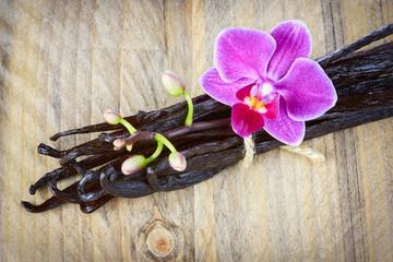 Vanilla sticks and orchid flower
