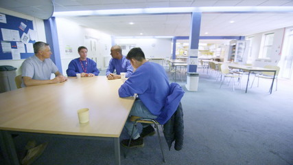 Manual workers taking a break in the company canteen