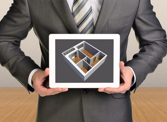 Man holding tablet with three-dimensional model in screen