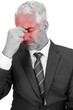 Upset businessman closing his eyes and holding his head