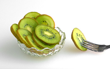 Bowl of kiwi with fork to the side