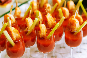 Catering - snack cocktails with tomato juice and shrimps. Closeu