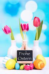 osterarangement mit tulpen und eiern