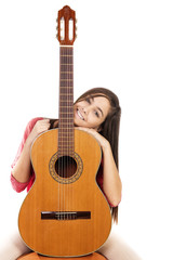 Portrait of pretty teenage girl and her guitar