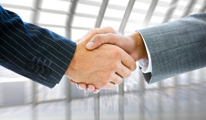 Composite image of business people shaking hands