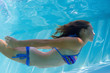 Young lady swimming underwater
