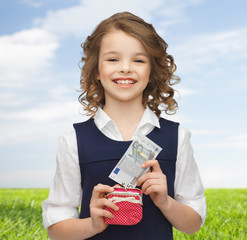 happy girl with purse and paper money