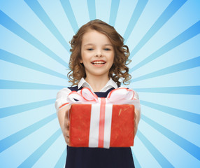 happy girl with red gift box over blue