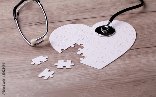 Stethoscope and puzzle, concept of Solution - 80525494
