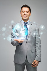 happy businessman in suit showing global network