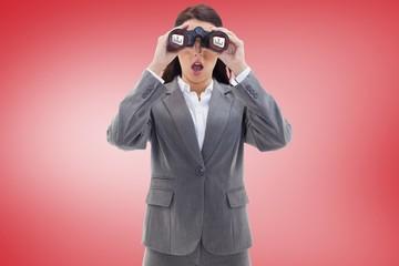 Surprised businesswoman looking through binoculars