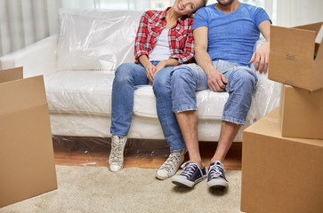 close up of couple relaxing on sofa in new home