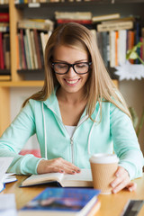 student girl reading book and drinking coffee