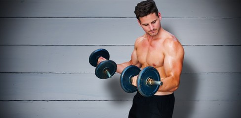 Composite image of bodybuilder lifting dumbbell