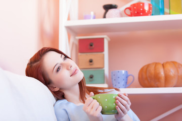 d girl in blue blouse with green cup