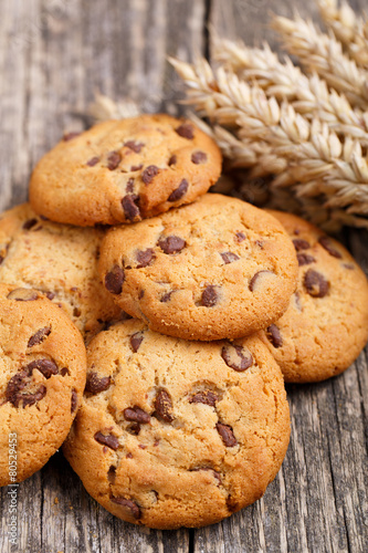 Papiers peints Confiserie Cookies with wheat on a wooden table.