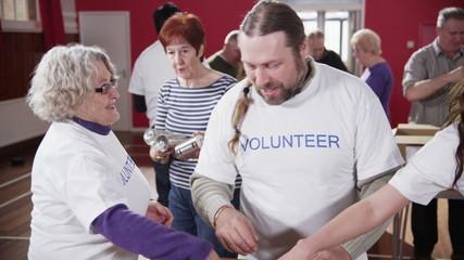 Charity volunteers sorting through donated goods