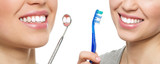 Oral hygiene. Teeth treatment. Young girl with brush and mirror