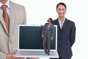 Composite image of businessman standing and looking