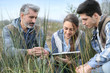 Teacher with students in agronomy looking at vegetation - 80533282