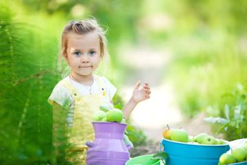 Happy kid in a apples garden