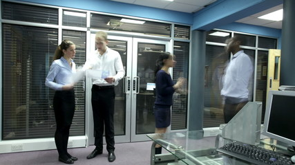Time lapse of professional group of people at work in a busy office.