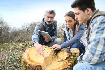 Teacher with students in environment sciences