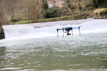 View of drone flying over river