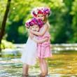 Two little sisters wearing flower crowns